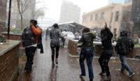 Johannesburg residents run for cover during an unusual snowfall that hit parts of the city on Tuesday (Reuters).