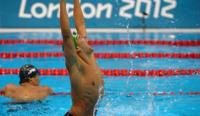 South Africa's Chad le Clos celebrates winning gold in the men's 200m butterfly final at the Aquatics Centre in London.(Photo: Assoicated Press)