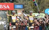 Christoph Sauser and Burry Stander of 360One Songo Specialized celebrate overall victory in the 2012 Absa Cape Epic (Photo: Absa Cape Epic)