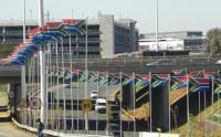 Flags line the highway leading in and out of Johannesburg's OR Tambo International Airport ahead of the 2010 Fifa World Cup