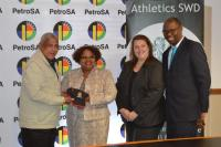 Moses Gericke and Michelle Jacobsz, the PetroSA race facilitators from SWD Athletics, flanking Nosizwe Nokwe-Macamo. On the right is Kholy Zono, PetroSA Operations acting vice-president. (Photo:  Mosselbay Advertiser)