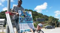 Knysna Rotary Interactor Wanga Mbabe and Rotarian Derrick Ikin put up the Knysna SPLASH posters.