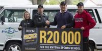 Knysna Sport School�s Iain Coetzee (second from right) receives a cheque for R20 000 from RECM Knysna 200 race director Patric Mosterd, as KSS manager Jan van Wageningen (far right) and Louise Wilson of Garden Route Events look on. Photo: Julie-Ann Photog