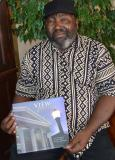 Welile Falake with his copy of the book. (Photo: Cornelle Carstens)