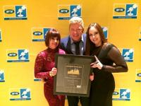 At the MTN Radio awards are, from the left, Algoa FM graphics designer Marna Haskins, graphic designer, operations director Alfie Jay and creative director Nadie Pieterse.
