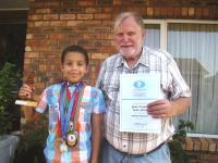 The A team: SA u.10 Junior National Chess Champion Michael Sweetbert from George with his chess coach Terry Quirk, from Sedgefield. The medals around Michael's neck are medals he won during 2014.