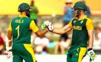 Hashim Amla and Faf du Plessis celebrate their 200-run partnership during theirICC World Cup Pool B match at Canberra on Tuesday 3 March 2015. (Image: Cricket SA)