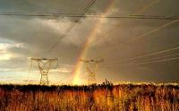 Rainbow over electricity pylons in South Africa's Free State province (Photo: Chris Kirchhoff, MediaClubSouthAfrica.com)
