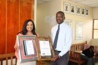 Shirley Herman (left) winner of the 'Excellence in teaching Mathematics' award certificate with Robert Grootboom, Principal of Dellville Park Primary.