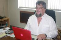 Gert Nel, owner of AET Industrial Park, behind his pink Apple laptop.