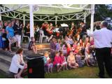 Pack a picnic basket and enjoy the beautiful setting in the botanical garden at the annual Carols by Candlelight symphony concert.