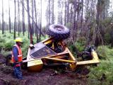 An employee of ZD Stander en Seuns Vervoer en Ontginning inspects the Bell logger damaged by an elephant on Wednesday night 13 May.